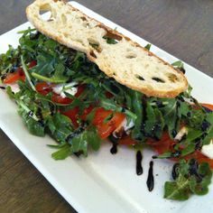 5 Doors Down - Tomato and Bocconcini Salad topped with Arugula and a Balsamic Reduction Drizzle! Salad Topping, Balsamic Reduction, Arugula, Vegetable Pizza, Sandwiches, Yummy Food, Doors, Fresh