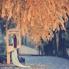 Hanging on the telephone: A model's hair hangs out of a vintage telephone box in a Rapunzel-style against the backdrop of an autumnal landsc...
