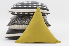Black theme with a tinge of Moss Green Triangle Cushion #colorcombos #furnituredecor