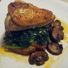 Late Dinner is served. Enjoy... ;)    Roasted Chicken Breast with Sauteed Spinach and Roasted Fingerling Potatoes with Baby Protabella Mushrooms.