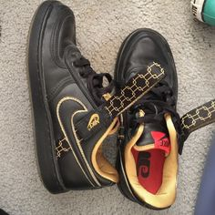 Black and gold Nikes  best offer Still in great shape worn a few times best offer Nike Shoes