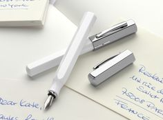 Faber Castell Stilou Ondoro White (fountain pen) www.Jarrive.ro -- I strangely like the look of this pen. It reminds me of an old-fashioned milk bottle.
