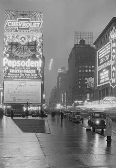 1931.. Seventh Avenue  from 46th Street and Broadway..Oval Chevrolet-Pepsodent Tooth-Paste-Camels of 1930-32. Studebaker Building.. Loews Mayfair (Hotel Longacre) or Columbia Bldg... Hotel Taft