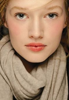 Blushed makeup look with stained lips.
