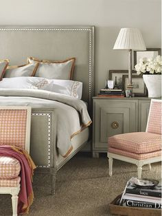 ❁ taupes/pinks, a simple yet classic padded headboard, great design books & the cutest tiny Eiffel towers make this guest room chic!