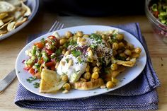 baked chickpeas with pita chips and yogurt - smitten kitchen is head-over-heels for these
