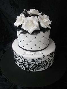 Black and White Cake with stencil work and pearls, gumpaste roses and black tulle in gaps