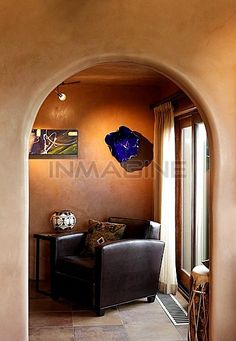 Leather Armchair With Side Table Through Archway At Home Stock Photos / Pictures / Photography / Royalty Free Images at Inmagine