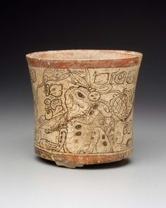 Cylinder vase | Museum of Fine Arts, Boston] Maya A.D. 680–750 Place of Manufacture, Nakbé area, El Petén, El Mirador Basin, Guatemala Codex-style vase depicting three supernatural shamanic co-essences (wayob), including a waterlily-toad, a dog-jaguar wearing a fringed scarf, and a monkey with a deer's ear and antlers.
