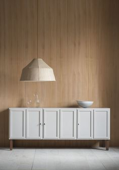 The Frey sideboard has 3 double panelled doors which open to reveal timber-lined locking cupboards, each housing an adjustable shelf and integrated cable access in the base.