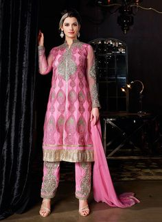 http://www.sareebuzz.in/salwar-kameez/modern-pink-net-embroidered-pant-style-suit-8389  Modern Pink Net Embroidered Pant Style Suit  Item Code: : 8389  Occasion : Ceremonial Reception  Color : Pink  Fabric : Net  Work : Embroidered Lace  For Inquiry Or Any Query Related To Product, Contact :- +91 9974 111 22