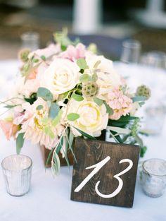 Rustic painted wood table numbers: http://www.stylemepretty.com/california-weddings/santa-margarita/2015/12/28/romantic-rustic-spanish-oaks-ranch-wedding/ | Photography: Jen Rodriguez - http://www.jen-rodriguez.com/