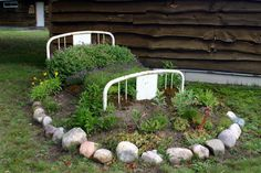 """bed frame planter...  I got this from an article about rednecks. Fail to see the difference between this and other """"upcycles"""" except for who does it. Hipster chick = cool and chic, cute upcycle, while Norma Sue = blight on the neighborhood we must humiliate for her poor aesthetics"""