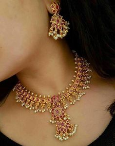 Code Beautiful necklace with pink color beads and guttapusala hanging. Price 2280 rs free allover india Whatasp 9908278128 to order Indian Wedding Jewelry, Bridal Jewelry, Beaded Jewelry, Gold Jewelry, Gold Necklace, Indian Jewelry, Diamond Necklaces, Pearl Jewelry, Necklace Set