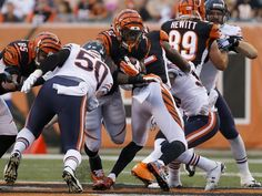 Walkthrough: A reminder about Bengals run game. Photo: Cincinnati Bengals running back Jeremy Hill (32) breaks through the line of scrimmage on a run in the first quarter. The Enquirer/Kareem Elgazzar