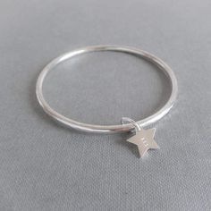 Personalised handmade silver bangle. Hand cut silver star personalised with your initial and set on a handmade solid silver bangle. Made by hand. Take a look at my website for more information: www.SilverZoo.co.uk and follow me on facebook to see behind the scenes and new products first: www.facebook.com/silverzoo.co.uk