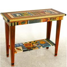 Sarah grant table, $1,530. love the designs on the side