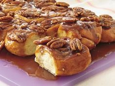 Who wouldn't be happy when offered one of these rich, delicious pinwheels of warm raised yeast dough topped with pecans?