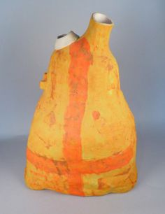 Yellow and orange gas can with spiral and cross c. 1990 by artist Rick Dillingham