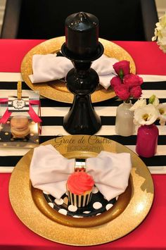 Gold, black and red place settings at a Kate Spade birthday party! See more party ideas at CatchMyParty.com!