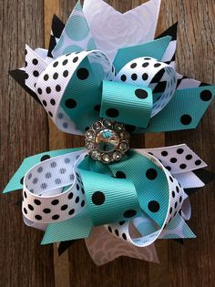 Large aqua, black and white boutique hair bow. This bow is hand sewn together. It has a lined alligator clip on the back. PLEASE LIKE US ON FACEBOOK: 3
