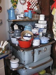 Vintage enamel cookware.  This woman is clearly obsessed.  (Oops, I have a neat old cast iron enamel stove too.)