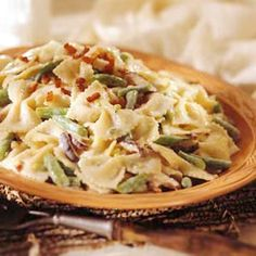 Creamy Green Beans and Pasta Creamy yogurt-mustard sauce tossed with green beans, bow-tie pasta, and pancetta make up this quick-to-fix pasta dish.