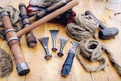 Traditional Shipbuilding Tools.  Wooden caulking mallets, caulking irons, a reefing iron and oakum. (Photo by J.R. Braugh).  Maine Windjammer Cruises