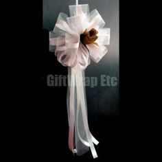 Something like this only in cream with baby blue and a brown sea shell instead of a flower.