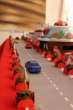 """Cute table runner for the center. Include large """"hot wheels"""" with balloons attached as decor"""