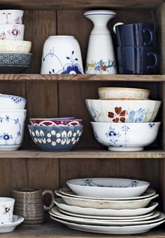 Display your beautiful china in an open closet. Here a mix of old and new ceramics and porcelain.