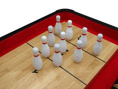 A set of miniature bowling pins can convert shuffleboard into a completely different game. Just set the table up as if it were a miniature bowling lane, and you'll have another reason to have hours of fun. Another use for your shuffleboard table will let you have a better time with it too.