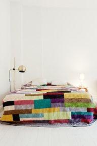Colorful quilt + quiet room.