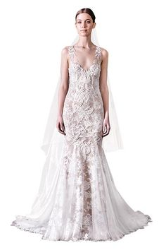 White or ivory lace over a nude shade has undeniably luxurious appeal.Wedding gown by Monique Lhuillier.Check out more gorgeous dresses in our Monique Lhuillier gown gallery ►