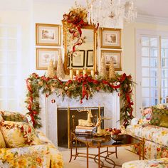 For the holiday season, gold branches and candles and a sprawling swag of greenery highlight the fireplace with festive charm. Ornaments dangle at varying heights, and gold-painted trees stand sentinel at either end of the mantel, playing off the antique mirror and gold-framed antique prints.