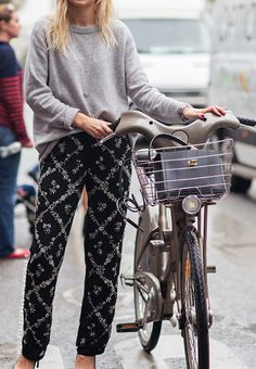 Enough is never enough. Cute casual weekend outfit: loose grey knit and embellished black pants for a ride on a bike