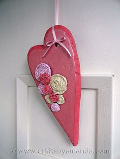 This Valentines Day craft will look stunning hanging on your front door this February.