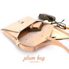 mariela dias: plum bag · 100% leather