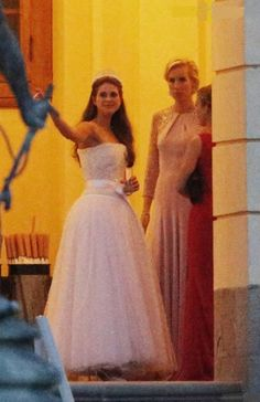 (L) Princess Madeleine wore a Nina Ricci gown to her wedding reception at Drottningholm Palace