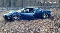 2001 Ferrari 360 Modena Description: Spun out on a patch of black ice. The car went up the guardrail and landed on its roof taking out a utility pole in the interim.