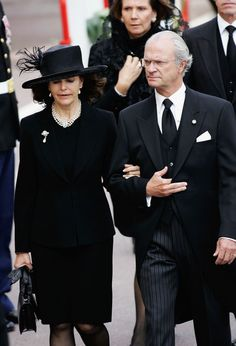 Funeral wear. (King of Sweden Carl XVI Gustav and Queen Silvia arrive for the funeral of Monaco's Prince Rainier III at Monaco Cathedral on April 15, 2005)