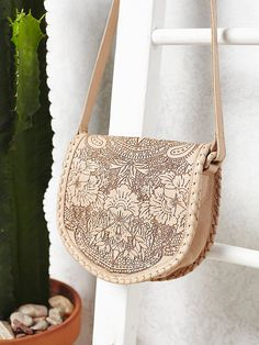 Cleobella Santa Anna Crossbody leather saddle bag featuring a floral etched design $198   Free People