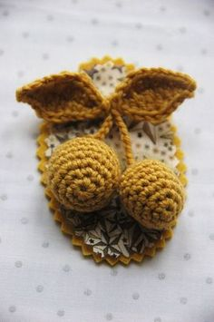 Crochet cherries would look great if done in red and green with a contrasting color for the back part.
