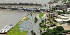 Flooding of the Mississippi River reaches past River Drive and 4th Streets in Davenport, Thursday, July 3, 2014, as the crest approaches Friday. (John Schultz, Quad-City Times)