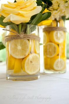 These DIY centerpieces are all sunshine, with buttercup yellow roses and a zing of lemon. Twine wrapped around the vases adds a bit of rustic charm. diy centerpieces simple 25 Stunningly Fresh Wedding Centerpieces With Fruit Summer Table Decorations, Wedding Decorations, Wedding Themes, Wedding Ideas, Trendy Wedding, Wedding Summer, Diy Wedding, Yellow Party Decorations, Wedding Colors