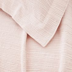 Pine Cone Hill | Hardwood Sunrise Pink Matelassé Coverlet | A modern take on the matelassé coverlet with a tone-on-tone, branchlike stripe. 100% stonewashed cotton.