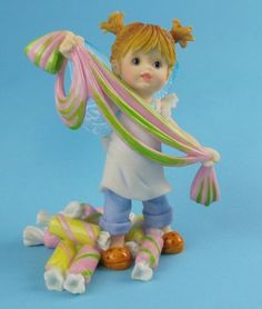Taffy Fairie - $24.99 - Ahh, the boardwalk. Surf and sand and shops and... salt water taffy! No beach-side candy store would be complete without it. This little pixie is working on pulling some!