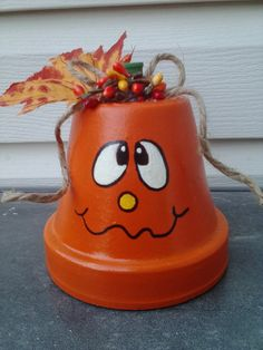 This little clay pot pumpkin stands 5 inches high to his stem which is a painted spool. 4 inches wide with a jute twine bow, a fall leaf and berries. Hand painted and finished with 3 coats of acrylic gloss sealer. You can keep him out Halloween thru Thanksgiving!  Want to meet his cousin? :) https://www.etsy.com/listing/199415948/claypot-pumpkin-fall-decor-halloween?  Meet his Halloween friends here…