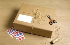Wrapped parcel with string, scissors and stickers - Peter Dazeley/Photographer's Choice/Getty Images Prepper Websites, Making Life Easier, Gift Certificates, Food Gifts, Dollar Stores, Basket Weaving, Make It Simple, Presents, Packaging