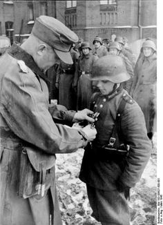 One of the Hitler Youth soldiers getting an Iron Cross. Last days of the war.